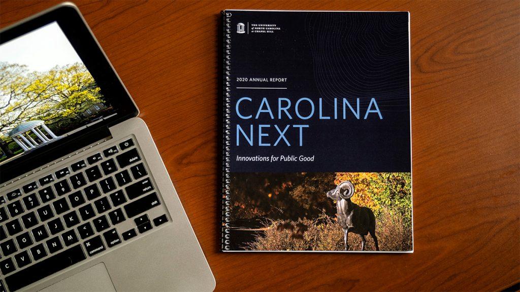 Carolina Next report next to a laptop