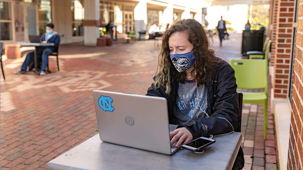 woman working on a laptop outdoors